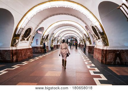 ST PETERSBURG, RUSSIA - MARCH 20, 2017: Inside Ploshchad Vosstaniya metro station - one of the centrally located station in Saint Petersburg, Russia. Illuminated vestibule with unidentified people