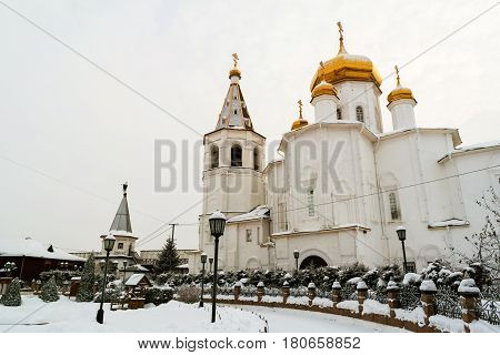 Tyumen, Russia. Holy Trinity monastery in Tyumen, Russia in winter during the cold and cloudy day. Popular landmark in siberian town