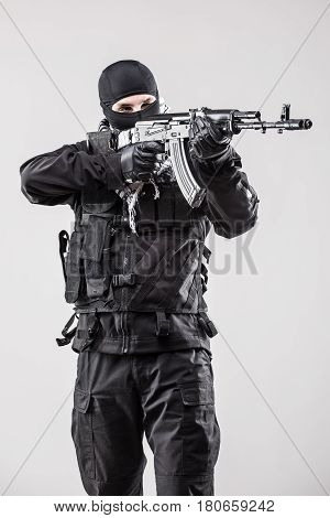 Terrorist Holding A Machine Gun In His Hands Aim Isolated Over White