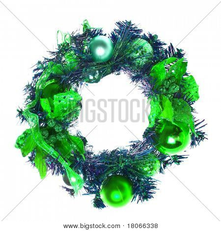 Green christmas garland with baubles and ribbons on white.