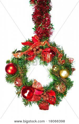 A hanging christmas wreath in green and red with colorful baubles