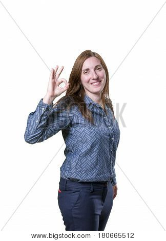 Pretty Business Woman Making Ok Gesture Over White Background