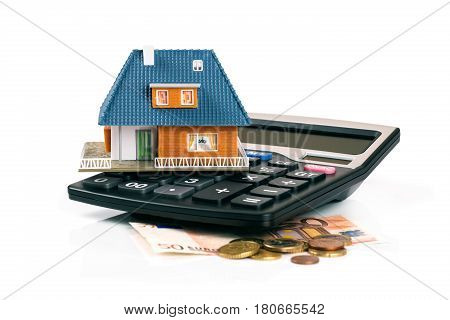 property tax and mortgage concept - house model on calculator