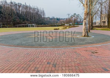Wide angle landscape of a country park located near Daejeon South Korea with soccer goal and trees in the background