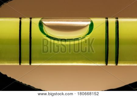 Tube with a liquid and with a bubble to measure the level of the angle of inclination of the surface
