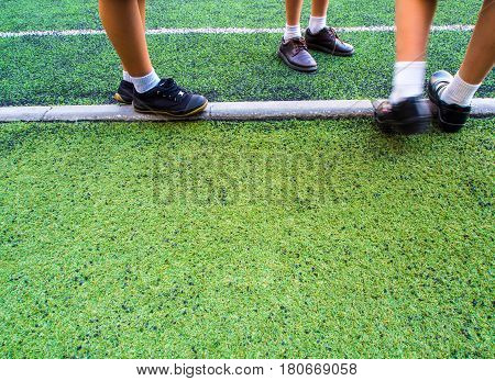 Children in the artificial turf of the school