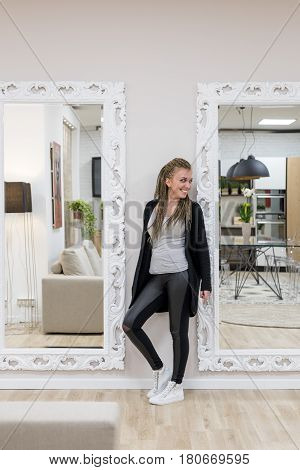 Young Woman In Dreadlocks Between Two Mirrors