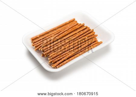 Salted Sticks In Plastic Plate. Snack In Plate Isolated On Whte Background