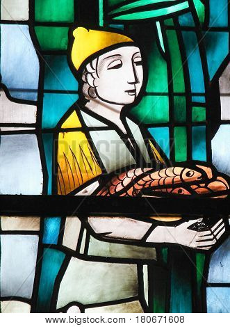 Stained Glass - A Boy Holding Fish