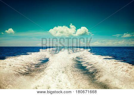 Background water surface behind of fast moving motor boat in vintage retro style. Vintage sky background - Vintage Filter