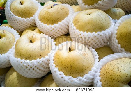 Whole Yellow Gong Pear Wrapped In Protective Foam
