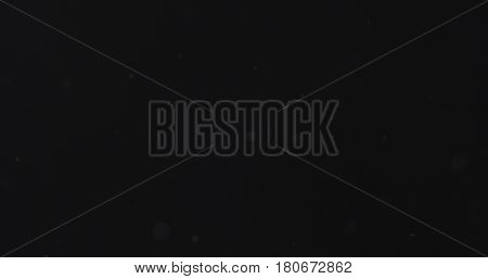 few dust particles over black background, 4k photo