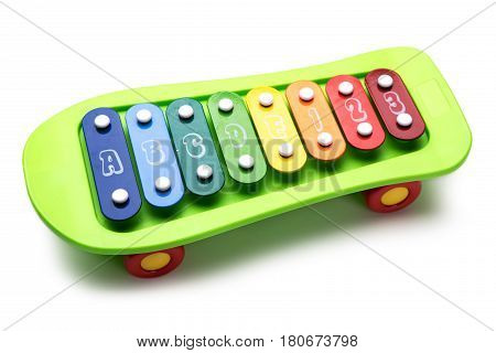 Skateboard colored toy xylophone isolated on white background.