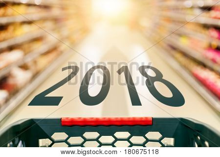 Shopping and success concept in supermarket for fast consumer lifestyle with predictions for upcoming 2018 year.