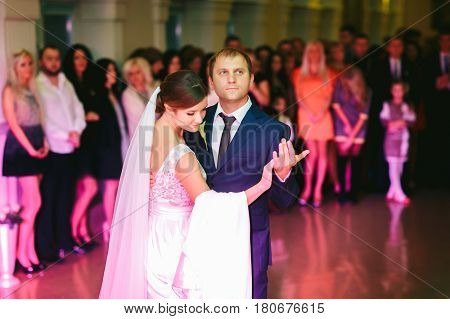 Groom Holds A Delicate Bride Tenderly During Their First Dance