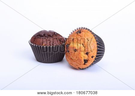 Fresh homemade muffins on white background. Top view