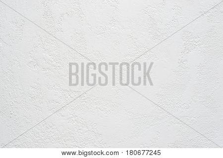 white travertine plaster textured background, copy space.