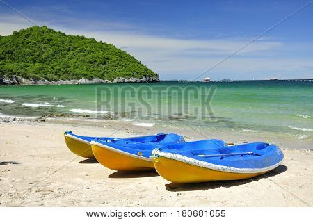 Canoe on sand beach with sunshine in Thailand