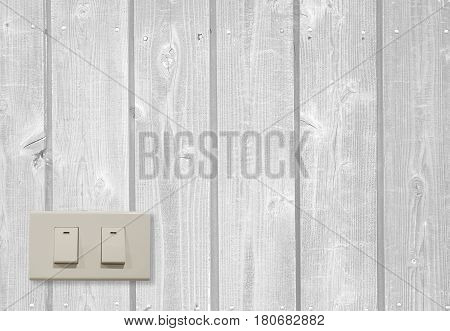 White electric switch on wooden wall and have copy space to input your text.