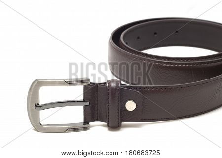 Close up of leather belt on white background