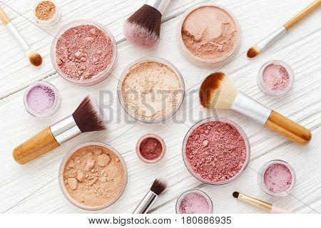 Makeup Powder And Brushes On White Wood Flat Lay