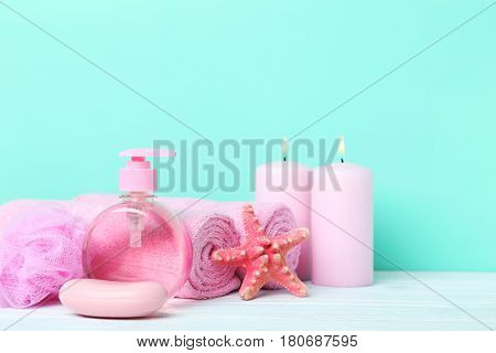 Pink Towels With Soap And Wisp On Green Background