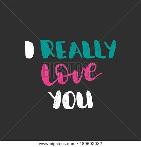 I really love you. Bright multi-colored romantic letters on dark background. Modern, stylish hand drawn lettering. Quote. Hand-painted inscription. Calligraphy poster, typography. Valentine's Day.