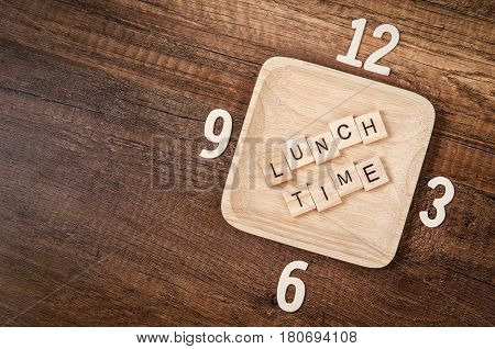 Lunch time wooden alphabet with number of clock. Lunch time concept.
