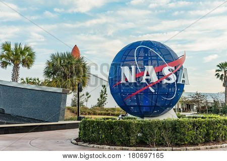 KENNEDY SPACE CENTER FLORIDA USA - FEBRUARY 18 2017: NASA logo on mock Globe on input to NASA Kennedy Space Center Apollo Saturn V Center at Kennedy Space Center Orlando Florida. This is the rocket used to go to the moon in 1969.