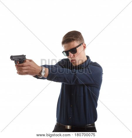 A young man with a handgun on white background
