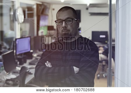 Portrait Of Young Businessman Relaxing At Office Space