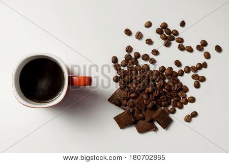 Cup Of Fragrant Coffee, Beans Coffee And Chocolate On White Background.