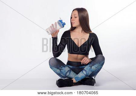 Female Athlete Drinks Water From Sport Bottle