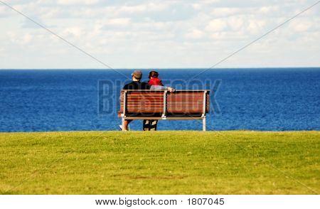 Couple Enjoying The Sea View