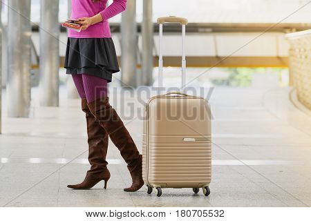 Young Asian Traveler Woman Holding Documents And Standing With Luggage Suitcase At Sidewalk
