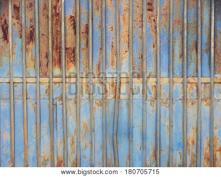 Textures of an iron fence background wallpaper color blue yellow material metal rust old surface