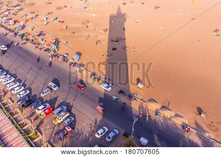 Birds eye view from light house and the shadow of light house, Marina Beach, Chennai, India. Jan 20 2016