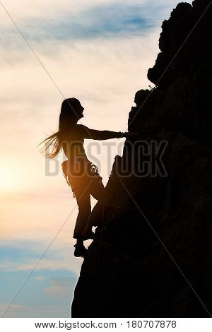 Girl Alone During A Climb In A Fantastic Mountain Landscape At Sunset