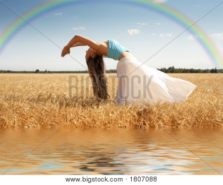 Stretching Woman With Rainbow And Water