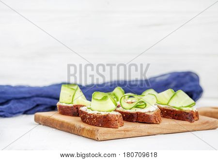 Sandwiches with cheese and cucumber. The concept of food and vegetarianism.