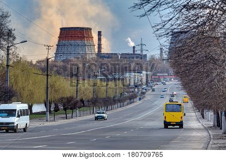 KRIVOY ROG, UKRAINE - MAR 25 - Photo with a view of the road and the plant
