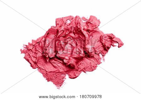 Pink cream Lipstick Sample smudged on white Surface