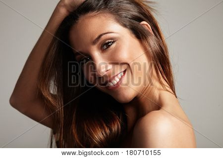 Closeup Portrait Of Smilimg Woman With Straight Long Hair