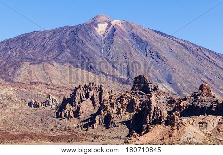 Large and strange formation of rocks and volcano at a distance. Pico del Teide Teide National park Tenerife Spain. Volcanic landscape. No people