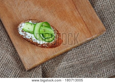 Sandwich with cucumber and feta cheese. Top view. The concept of food and vegetarianism.