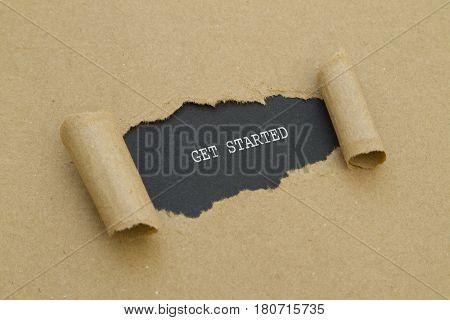 GET STARTED word written under torn paper.