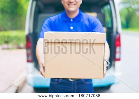Delivery Concept - Smiling Happy Young Asian Handsome Male Postal Delivery Courier Man In Front Of C
