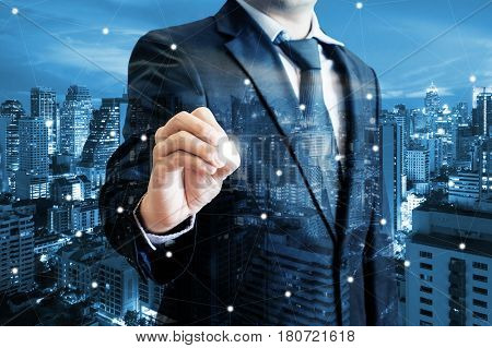 Double Exposure Of Professional Businessman Touching Screen With Stylus Pen And City Of Business In
