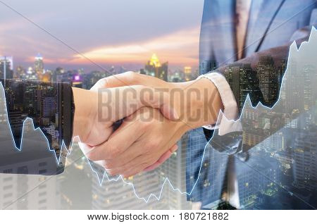 Double Exposure Of Businessman And Businesswoman Handshake Agree Deal With City Of Business In Blue