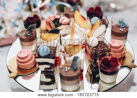 Luxury Wedding Catering, Table With Modern Desserts, Cupcakes, Sweets With Fruits. Delicious Candy B